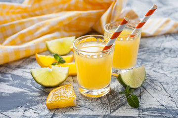 orange  juice in glasses on a table, selective focus