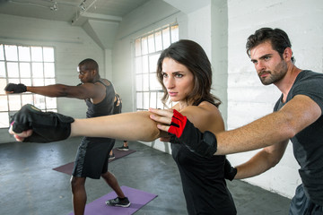 High intensity energy cardio burn fitness class lifestyle trainer training group punching exercise