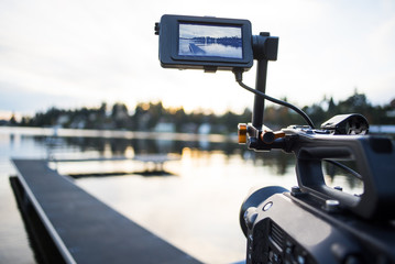 Camera Shooting Sunset Video Timelapse on the Lake