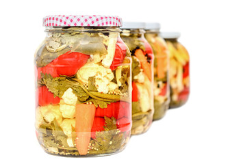 Jar with pickles containing cauliflower, cucumber, red pepper