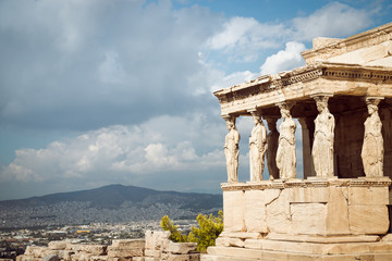 Acropolis, Erectheion, caryatids with panoramic view of the Athens, Greece