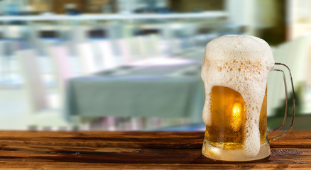 cold light beer mug in a pub