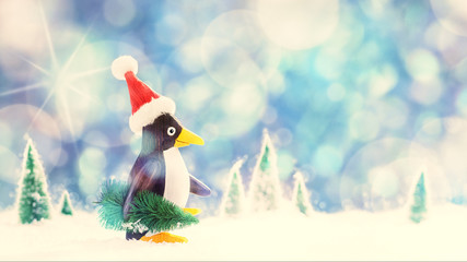 Penguin with Santa Hat Carries Christmas Tree