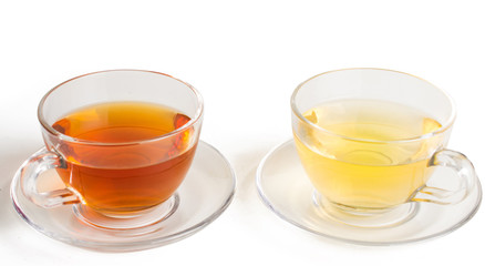 Green and black tea in a glass cup. On white, isolated background.