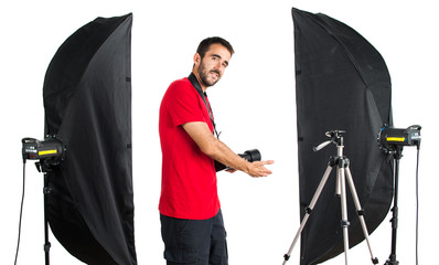 Photographer in his studio presenting something