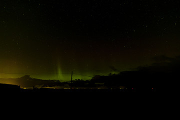 Northen lights seen over Scottish sea neat Edinburgh