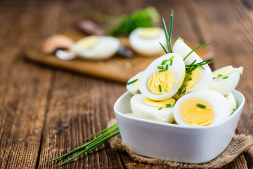 Halved Eggs on wooden background