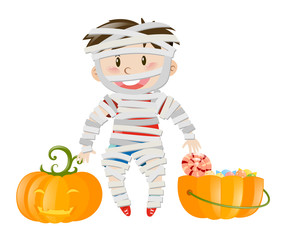 Halloween theme with boy in zombie costume