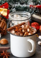 Hot chocolate with marshmallows, cinnamon and caramel sauce