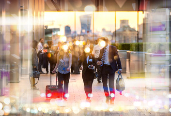 Business people walking in the City, blurred image with lights reflection. Business and modern life concept