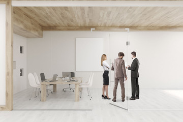 People talking in conference room with glass walls and doors
