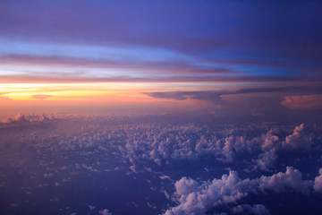 Aerial view from airplane flying above the clouds, Japan
