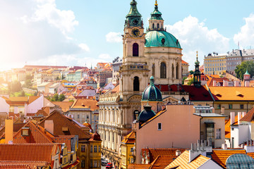 Spoed Fotobehang Praag Cityscape view on the lesser town with saint Nicholas church in Prague city