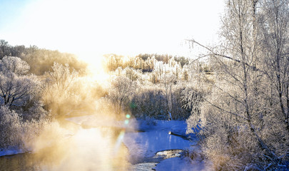 Winter sunny landscape with river and forest