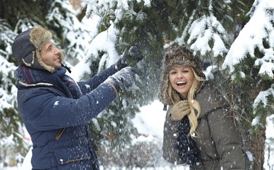 Young couple having winter fun