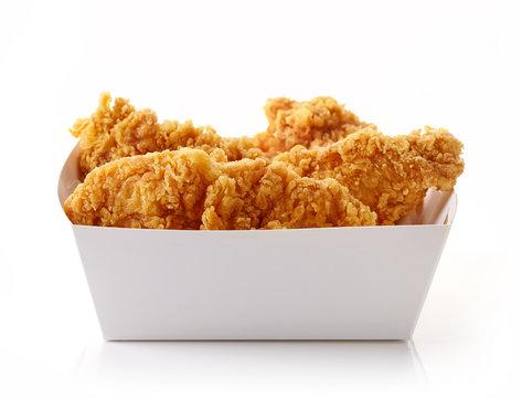Fried breaded chicken fillet in white cardbord box