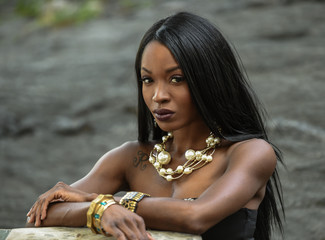 Outdoor portrait of beautiful African American woman.