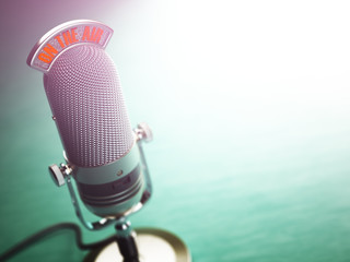 Retro old microphone with text on the air. Radio show or audio p