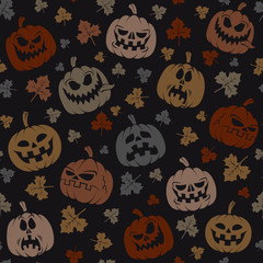 Halloween seamless pattern with silhouettes of pumpkins and leaves.