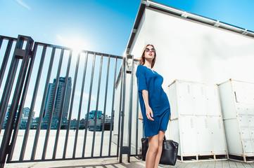 Pretty lady in blue dress