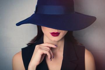 brunette woman in hat