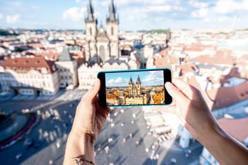 Photographing with smart phone the old town square of Prague