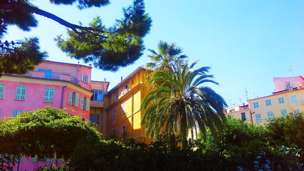 facades of old buildings with vivid wall paintings in Menton (France)