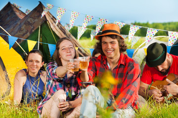 Young people drinking at summer festival