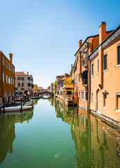 Chioggia houses create colorful reflections in the water of the