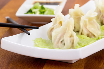 Steamed pork dumplings on plate closeup