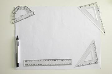 Ruler, pen and paper on desk