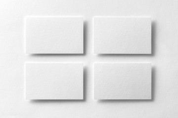 Mockup of four white business cards arranged in rows