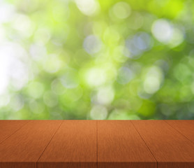 Wood table top on green bokeh background for display montage your products
