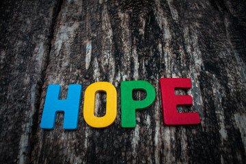word hope on wooden background