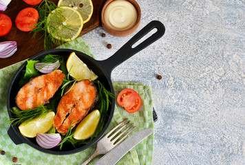 Salmon steak grilled with peppers and lemon