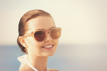 Young woman in sunglasses on beach
