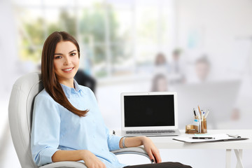 Young woman working at modern office. Business concept.