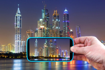 Making photos by smartphone in Dubai at night, UAE