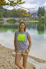 Beautiful woman is looking at camera at Lake Bohinj