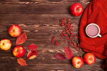 Autumn concept background. autumn still life with a cup of tea and apples