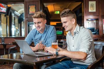 Friends working togetrher. Two businessmen friends men drinking