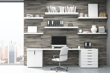 Home office with dark wood panels