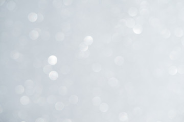 Unfocused abstract white glitter bokeh holiday background. Winter xmas holidays. Christmas.