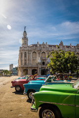 Cuban colorful vintage cars in front of the Gran Teatro - Havana, Cuba