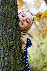 Little muslim girl in hijab - outdoor photo