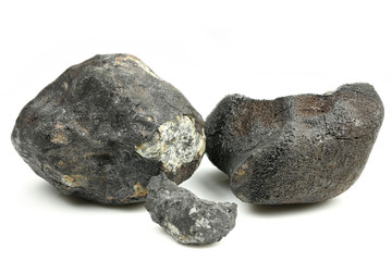 fragments of the Chelyabinsk meteorite (fallen 15 February 2013) isolated on white background