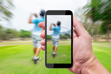 One using smartphone in golf course