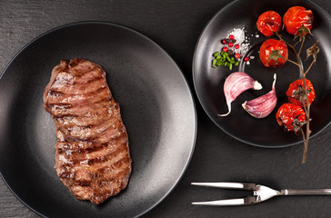 Wall Mural - Grilled Ribeye steak entrecote on black stone background