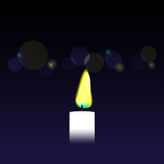 Candle on bokeh background