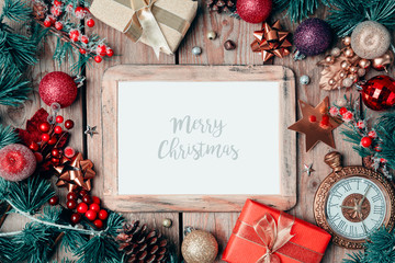 Christmas photo frame mock up template with decoration on wooden table. View from above